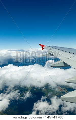 Above the clouds.Wing aircraft in the sky under earth of Germany.
