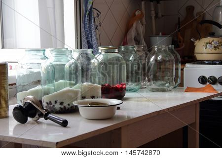 compote of berries of dogwood in a clear jar on your Desk storage for the winter