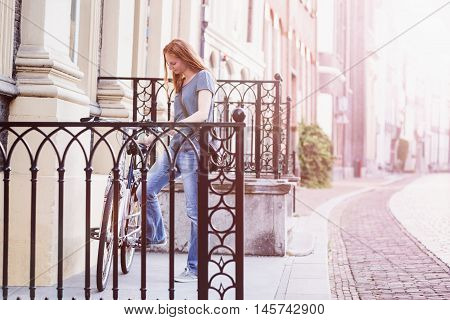 City Scene - Woman Parking A Bicycle