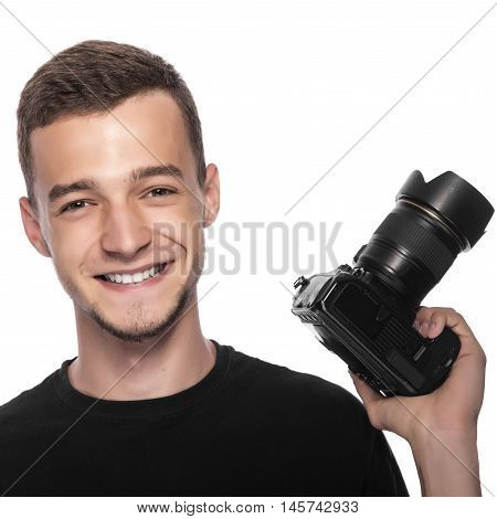 Handsome young man holding a DSLR camera. On white.