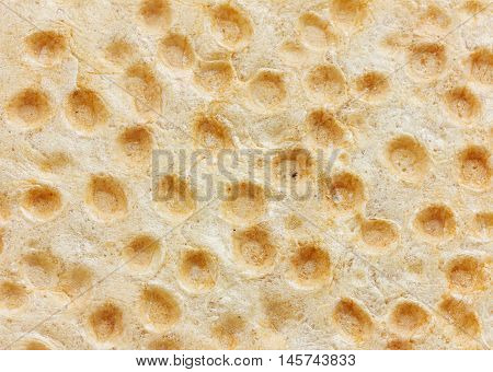 Abstract small loafs of bread, pancake or slapjack background. Can be used as gastronomy backdrop.