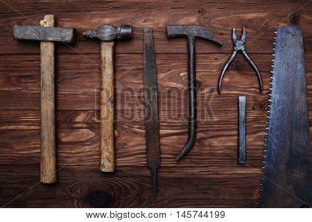A composition of old carpenter's tools isolated on wooden background