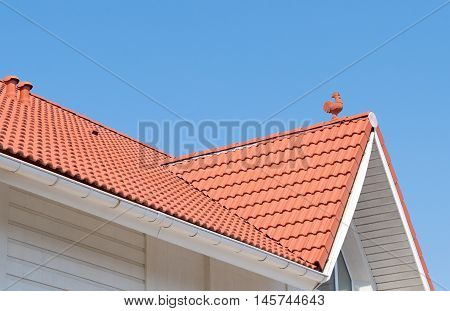 house from a red brick on background sky