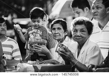 Prachuapkhirikhan Thailand - November 16 2015 : Unidentified child and senior woman of Buddhist To make merit in a Religious ceremony,black and white color picture style