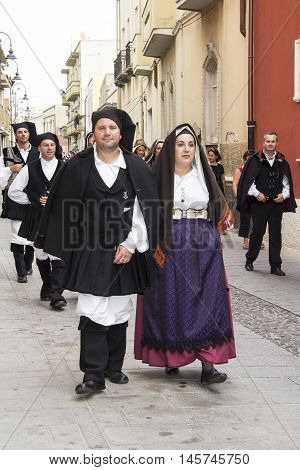 QUARTU S.E., ITALY - September 21, 2014: Parade of Sardinian costumes and floats for the grape festival in honor of the celebration of St. Helena. - Sardinia