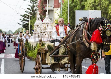SELARGIUS, ITALY - September 13, 2015: Former marriage Selargino - Sardinia - parade of a float carrying a traditional Sardinian sweet