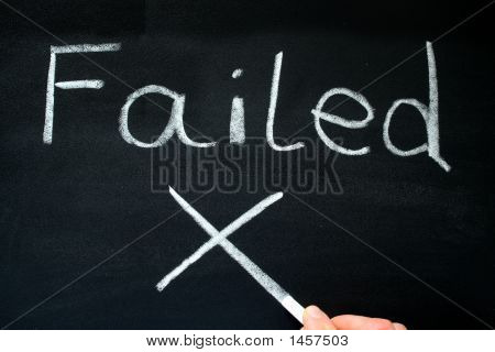 A Teacher Writing Failed On A Blackboard.