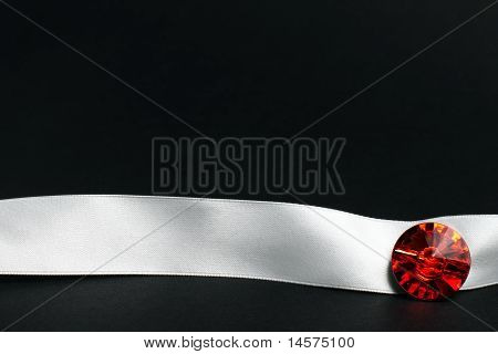 white ribbon with jewelry
