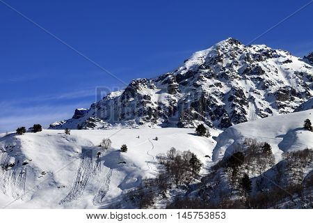 Off-piste Slope With Track From Avalanche On Sunny Day