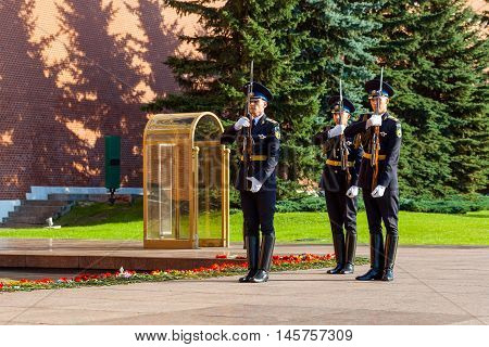 MOSCOW RUSSIA - SEPTEMBER 02 2016: Hourly change of the Presidential guard of Russia at the Tomb of Unknown soldier and Eternal flame in Alexander garden near Kremlin wall