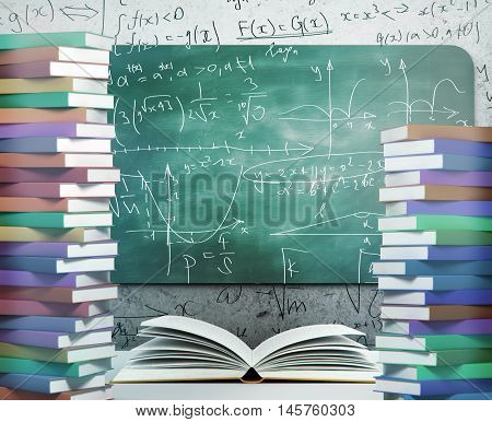 Mathematical formulas on chalkboard surrounded with colorful book. Education concept