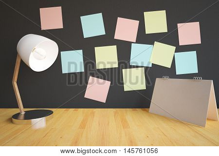 Closeup of creative workplace with table lamp empty calendar stand and colorful stickers on dark wall. 3D Rendering