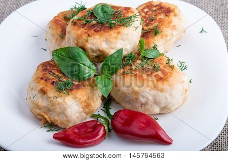 Rissole Of Minced Chicken Meat On A White Plate With Red Pepper