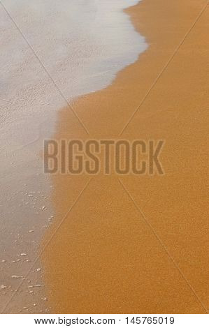 Half wet sand and wave background, a lot of space for text