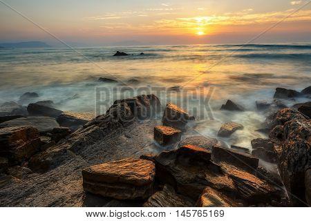 Sunset at Barrika beach in Bizkaia, Spain
