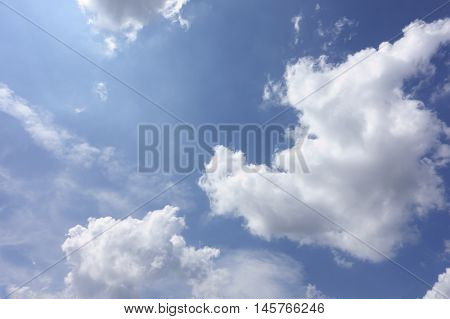 white clouds floating on a background of blue sky