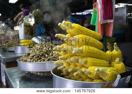 KOTA KINABALU MALAYSIA - SEPTEMBER 04 2016: Steamed sweet corns and peanuts for sale in a stall at Tanjung Aru Beach Sabah Borneo. Tanjung aru is beach is a famous beach in Kota Kinabalu city.