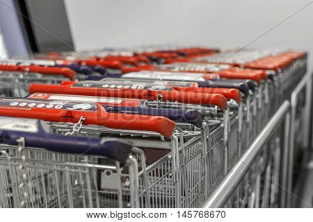 Collected in the number of shopping carts around a supermarket,red, blue,