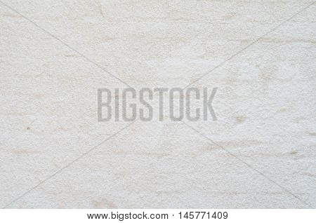 Background of white painted brick wall stucco coated
