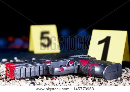 Bloody Gun At The Crime Scene In The Night