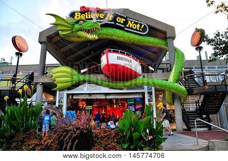 Baltimore Maryland 0- July 24 2013: A smoke breathing giant dragon hovers over the entrance to the Ripley's Believe It or Not! Museum at Inner Harbor