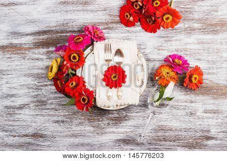 Tableware And Silverware With Zinnia