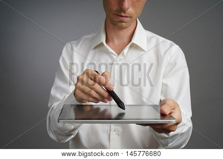 Man working on Tablet with Stylus
