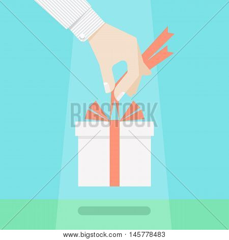 Gift of heaven concept. Coming a present from destiny, hand holding a gift box with bow of ribbon. Delivery of present from above, unexpected offering, important grant