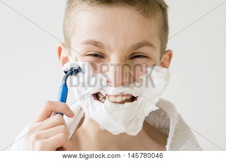 Excited Young Boy Shaving With Plastic Razor