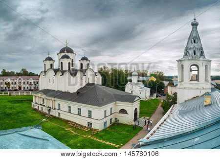 Summer birds eye view of Yaroslav Courtyard churches - St Nicholas Cathedral St Procopius Church and belfry. Veliky Novgorod Russia. Architecture landscape in cloudy weather