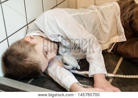 Fully Clothed Boy Unconscious On Shower Floor
