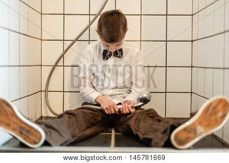 Unconscious Boy Holding Running Shower Head