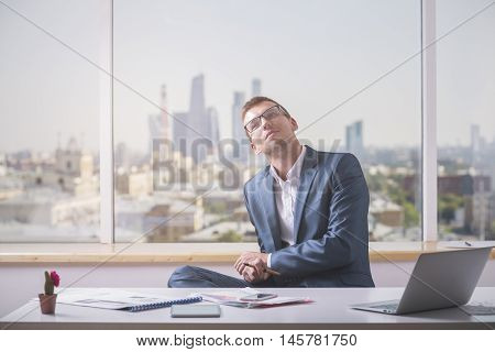 Daydreaming Businessman In Office