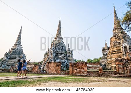 Tourists mother and daughter photography ancient ruins and pagoda of Wat Phra Si Sanphet Temple famous attractions at Phra Nakhon Si Ayutthaya Historical Park in Ayutthaya Province Thailand