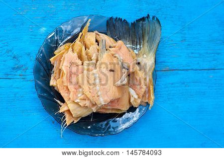 High Angle View of smoked fishes Served on Platter on blue Wood background. Kipper - food and drink