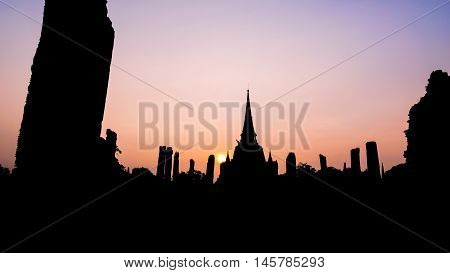 Silhouette for background Ancient ruins and pagoda of Wat Phra Si Sanphet old temple famous attractions during sunset at Phra Nakhon Si Ayutthaya Historical Park Thailand 16:9 wide screen