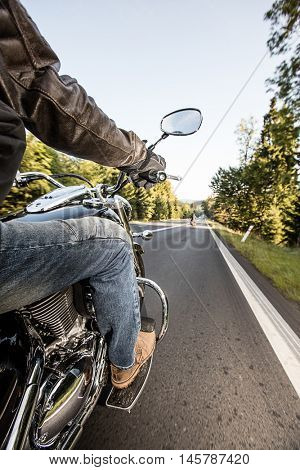 The view over the handlebars of high power cruiser motorcycle.