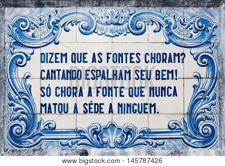 OVAR PORTUGAL - SEPTEMBER 3 2016: Panel of traditional Portuguese tiles hand-painted blue and white with written quoted verses from a poem about water.