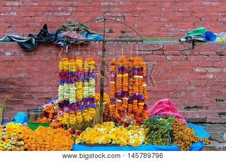 Marigold necklaces for sale at Durbar Square in Kathmandu, Nepal