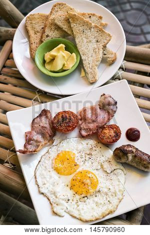 traditional classic english british fried breakfast with eggs bacon tomato sausage and toast set