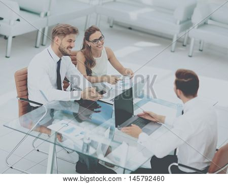 Three successful business person working.  High view