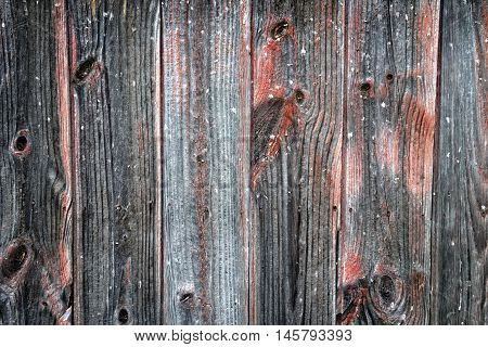 Aged weathered wood with nails cracks and knots.