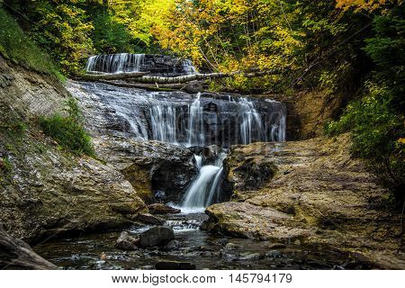 Sable Falls.  Waterfall in the Pictured Rocks National Lakeshore in Munising, Michigan. Pictured Rocks is located in the Upper Peninsula and is one of two designated national lakeshore in Michigan.