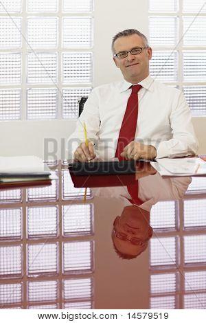 Mature Businessman Smiling At Camera