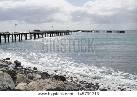 The old dilapidated jetty sitting behind the new jetty at Rapid Bay South Australia. Part of the Fleurieu Peninsula