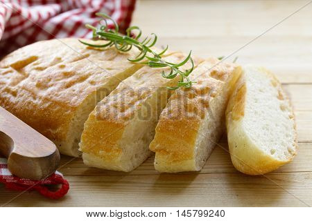 traditional Italian ciabatta bread on a wooden table