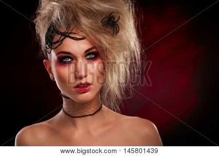 Artistic photo of spooky woman in halloween makeup.