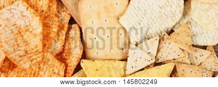 Heap Of Crunchy Cookies And Salted Crisps, Concept Of Unhealthy Food