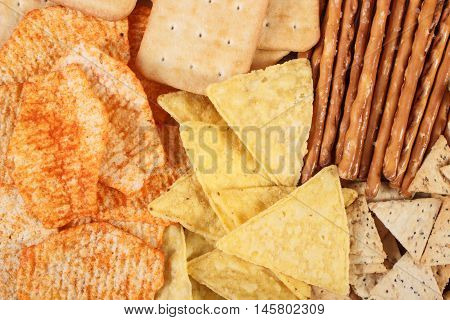 Heap Of Salted Crisps, Breadsticks And Cookies, Concept Of Unhealthy Food