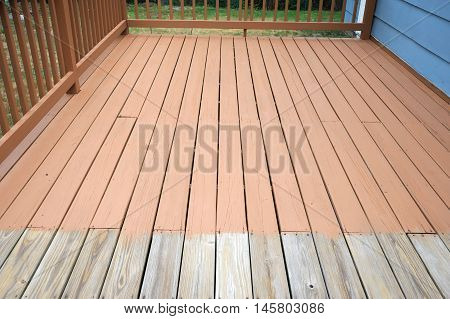 close up on partially painted old wood deck